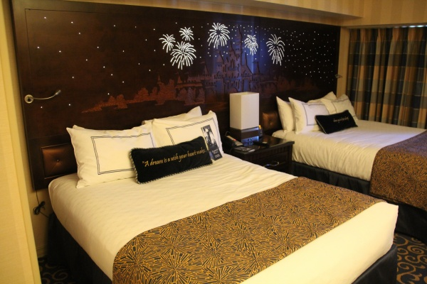 Magical Headboards featuring Sleeping Beauty Castle, Fireworks and Hidden Mickey's adorn the beds of Disneyland Hotel