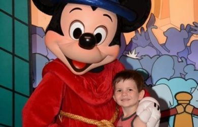 Disney Trip Traditions - Getting the perfect picture taken with Sorcerer Mickey is a tradition of ours. We have one from each trip!